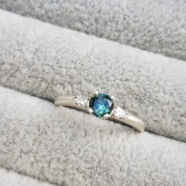 clawcup trilogy blue green sapphire with pear diamond